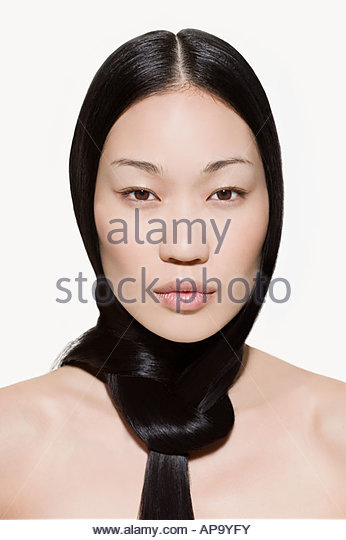 Woman with hair tied in a knot - Stock Image