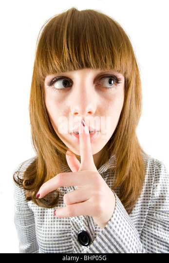 Pretty girl making a silence sign - Stock Image