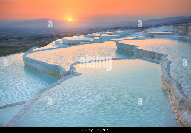 Pamukkale, sunset in the limestone terraces, Turkey - Stock Image