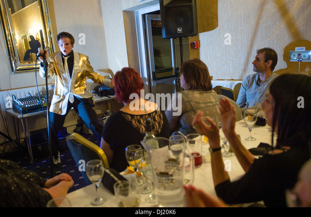 Chris Tierney, performing as a young Elvis Presley at a tribute night, Marine Hotel Aberystwyth UK - Stock Image