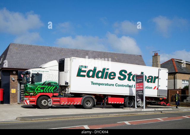 Eddie Stobart temperature controlled distribution delivery lorry delivering to a Tesco Express store. Wales UK Britain - Stock Image