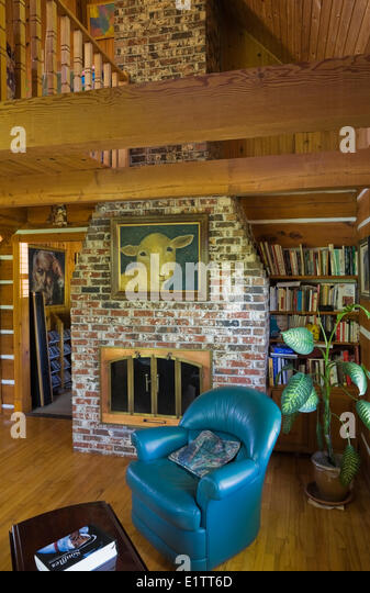 living room of a 1977 reproduction of an Old Canadiana cottage style Residential Log Home, Laval, Quebec, Canada - Stock Image