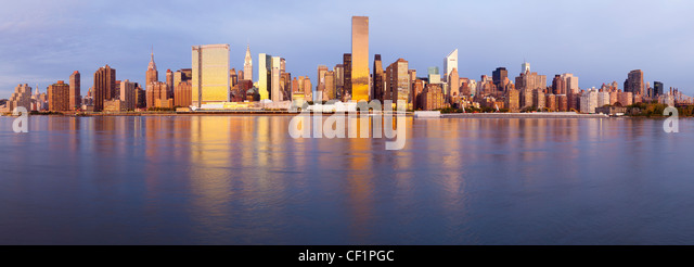 Skyline of Midtown Manhattan seen from the East River, New York, United States of America - Stock Image