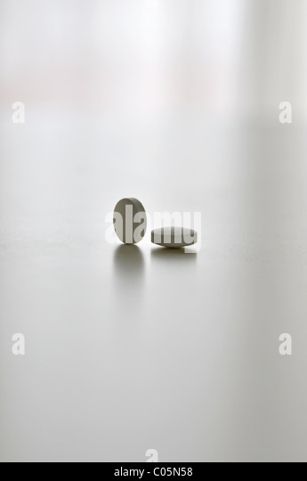 medicine on counter top, a dosage of two pills - Stock Image