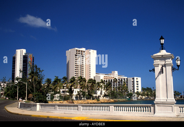 San Juan Skyline, Puerto Rico, showing resort hotel and bridge beside the blue Caribbean sea with blue sky and copy - Stock Image