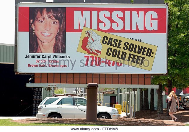 A driver passes a missing billboard for runaway bride Jennifer Wilbanks which was amended by Formetco after it was - Stock Image