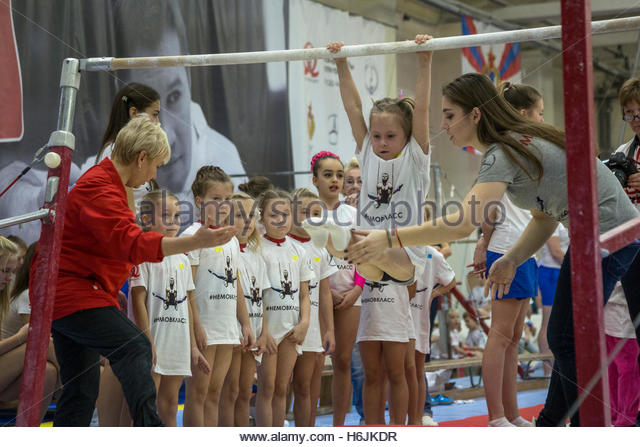 Russia's Olympic champion in artistic gymnastics Aliya Mustafina (right) during the master class in gymnastics - Stock Image