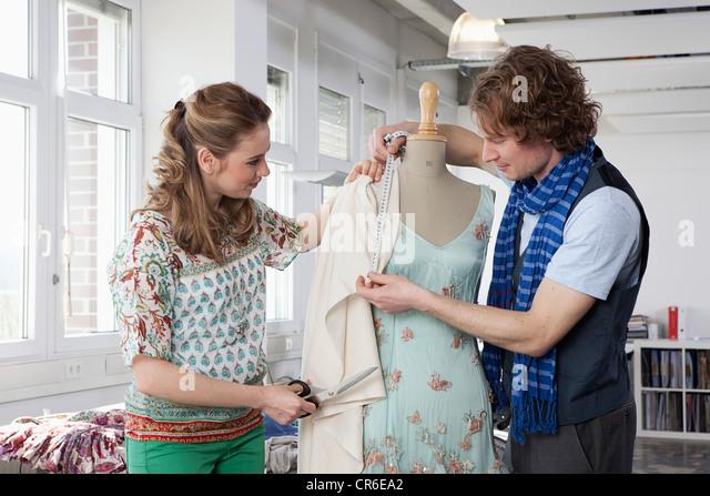 Germany, Bavaria, Munich, Fashion designers working - Stock Image