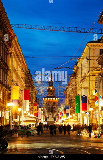 MILAN, ITALY - NOVEMBER 24: Via Dante shopping street with people at night on November 24, 2015 in Milan, Italy. - Stock Image