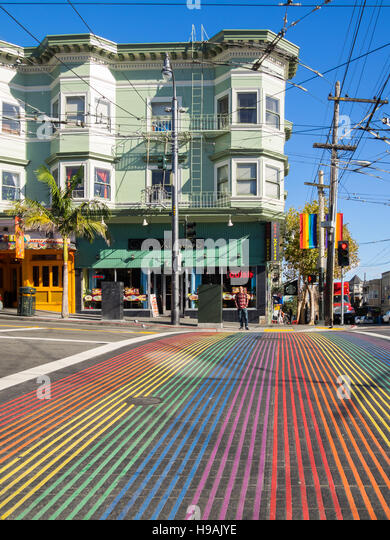 A rainbow crosswalk at the corner of 18th Street and Castro Street, in the Castro district of San Francisco, California. - Stock Image