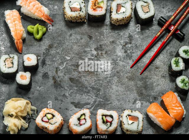 Traditional japanese food. Sushi rolls, nigiri, salmon, wasabi, shrimp, tuna, ginger, tofu, rice, avocado, pickled - Stock Image