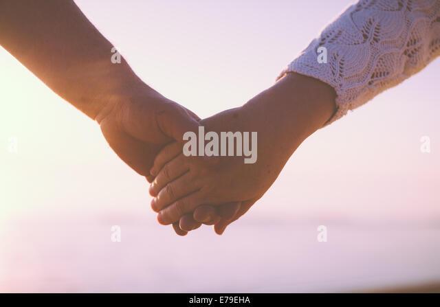 Senior couple holding hands - Stock-Bilder