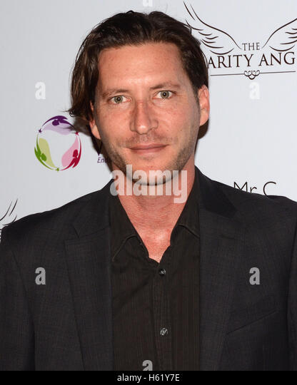 Mike Falkow attends BBQ And Bikinis Benefit hosted by Linda's Voice Foundation Honoring Beverly Johnson at Mr. - Stock Image