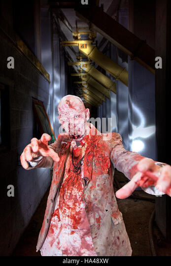 Walking dead zombie undead, man covered in blood, eating brains scary man, horror film, zombies voodoo, blood stained - Stock Image