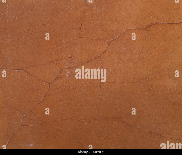coarse texture of the cement cracked walls covered with brown paint - Stock-Bilder