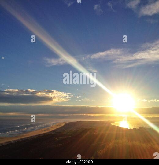 Sunrise over Farewell Spit. Northern tip of the South Island, New Zealand. - Stock Image
