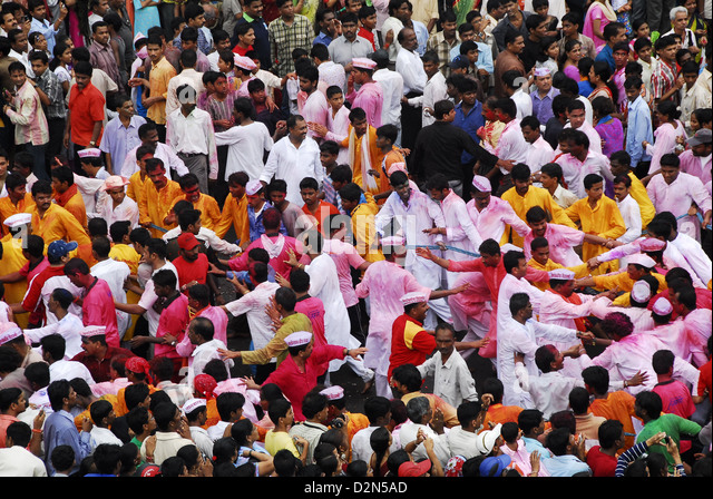 People forming a chain during the Ganesha idol procession to immersion, Mumbai, Maharashtra, India, Asia - Stock Image