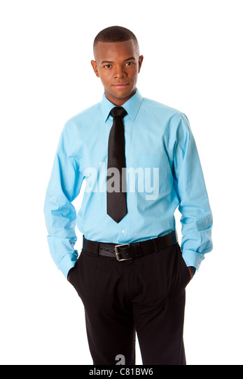 Handsome attractive successful corporate business executive standing with hands in pocket, isolated. - Stock Image