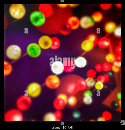 Coloured fairy lights - Stock Image