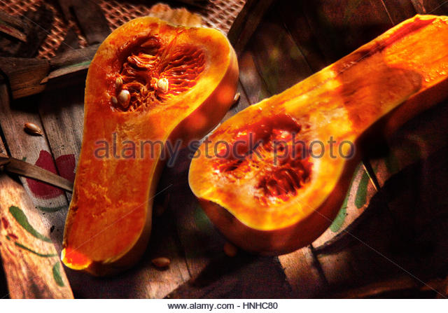 Butter nut squash in halfs on a barn setting - Stock Image
