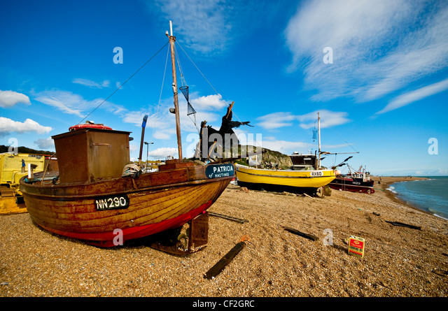 Fishing boats beached on the Stade at Hastings. - Stock Image