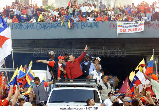 Venezuelan President Hugo Chavez waves to supporters in Caracas January  23, 2003. One person was killed and 12 - Stock Image