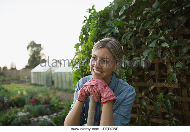 Woman standing in community garden - Stock Image