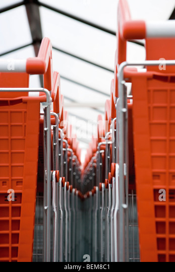 Shopping carts in rows, close-up - Stock Image