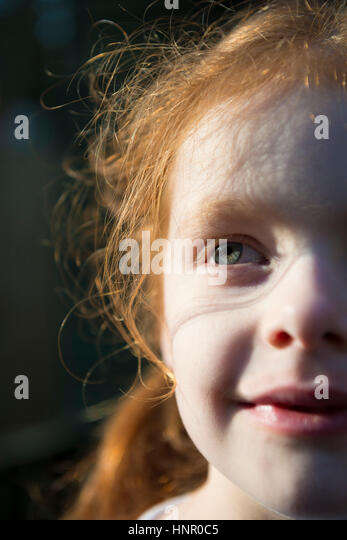 Portrait of a red haired 6 year old girl - Stock Image
