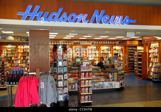 Boston Massachusetts Logan International Airport BOS gate area concourse shopping Hudson News newsstand books magazines - Stock Image