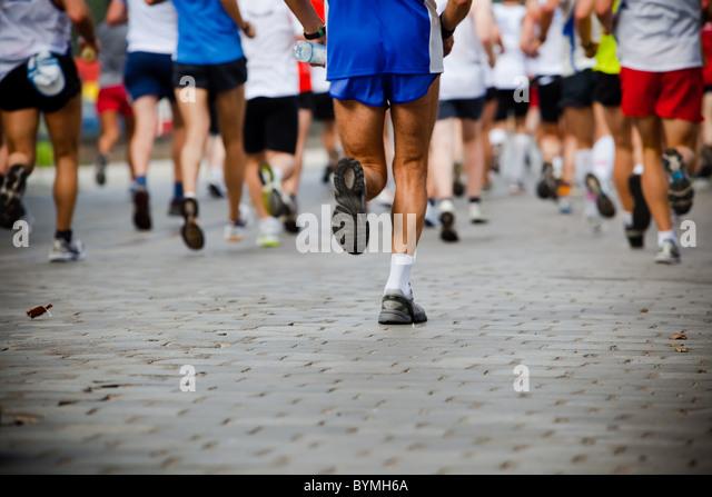 People running in city marathon - Stock Image