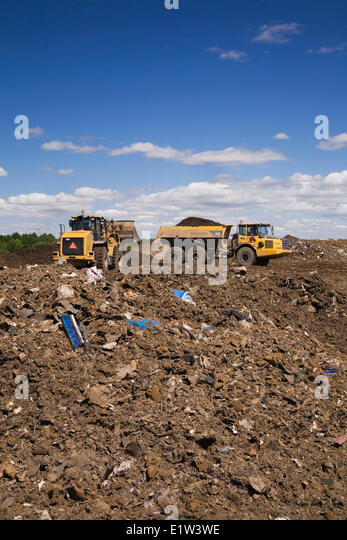 Volvo loader on a hilltop at a waste management site, Quebec, Canada - Stock Image