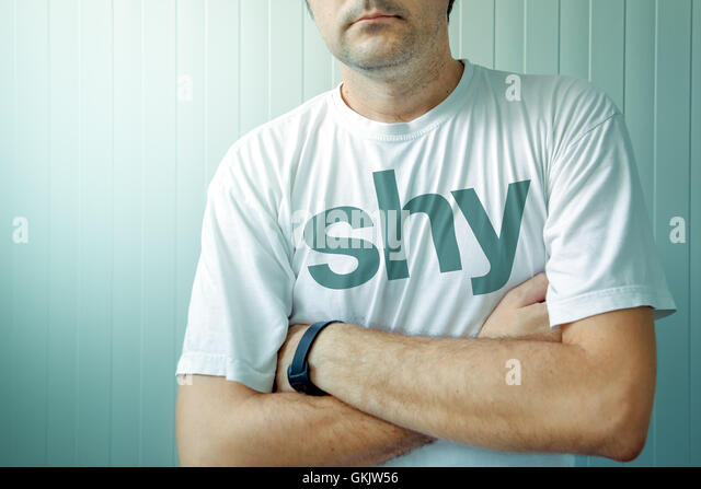 Adult man wearing shirt with Shy title - Stock Image