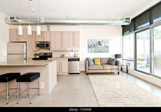 Kitchen and living room of loft apartment - artwork from photographer portfolio - Stock Image