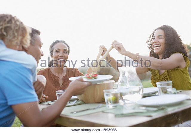 Family eating outdoors - Stock Image