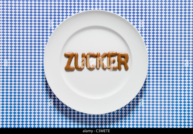 Word sugar written with russian bread on dish, close up - Stock Image