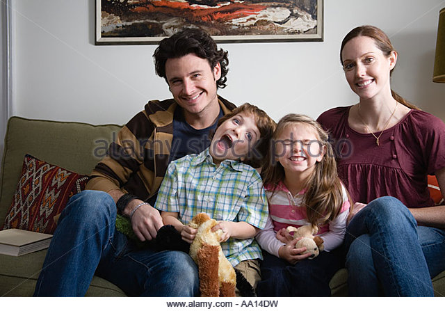 Cheeky children in family portrait - Stock Image