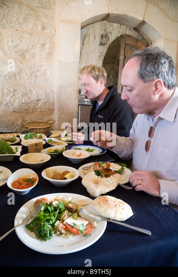 Tourists eating in a Jordan restaurant, Madaba, Jordan, Middle East - Stock Image