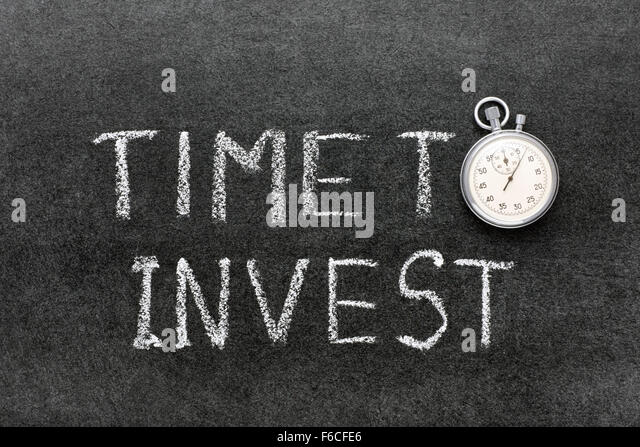 time to invest phrase handwritten on chalkboard with vintage precise stopwatch used instead of O - Stock Image