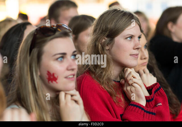 Wales rugby fans watch their team in a tense Rugby World Cup 2015 match against Fiji. - Stock Image