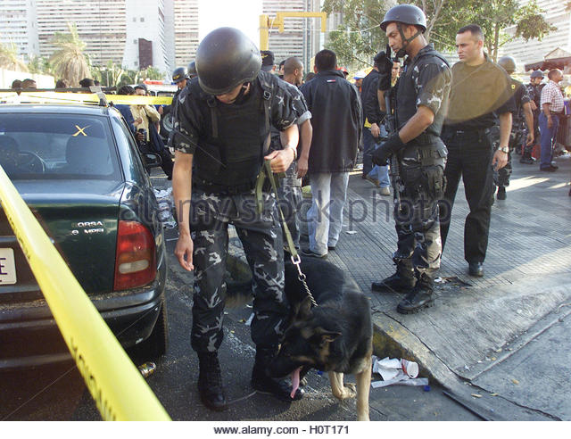 Police search for bombs in Caracas January 23, 2003. One person was  killed and 12 were injured when a suspected - Stock Image