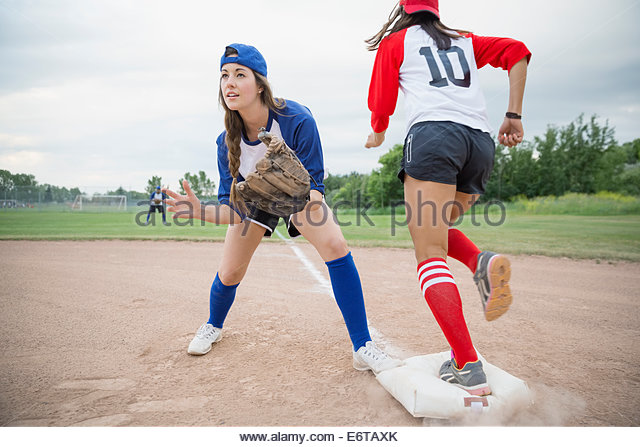 Baseball player ready to catch ball at base - Stock Image
