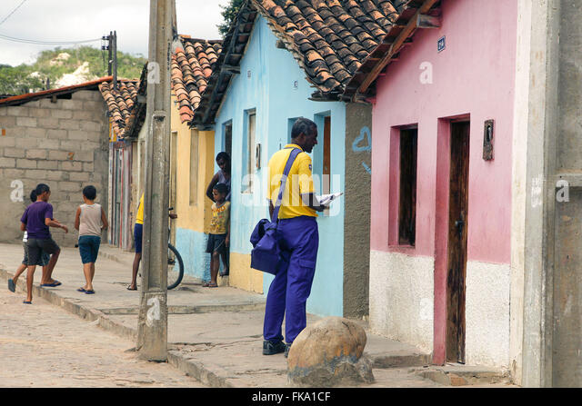 Postman delivers Correspondence in residence - Stock Image