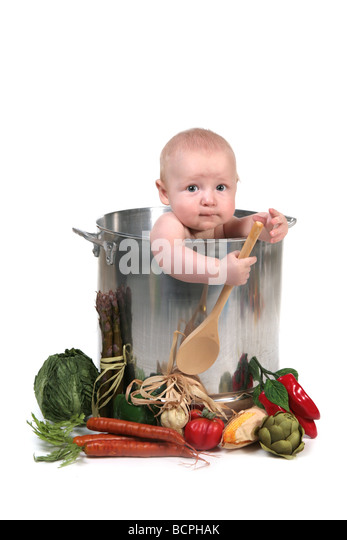 Cute Baby Infant Boy in a Chef Pot Prop on White Background - Stock Image
