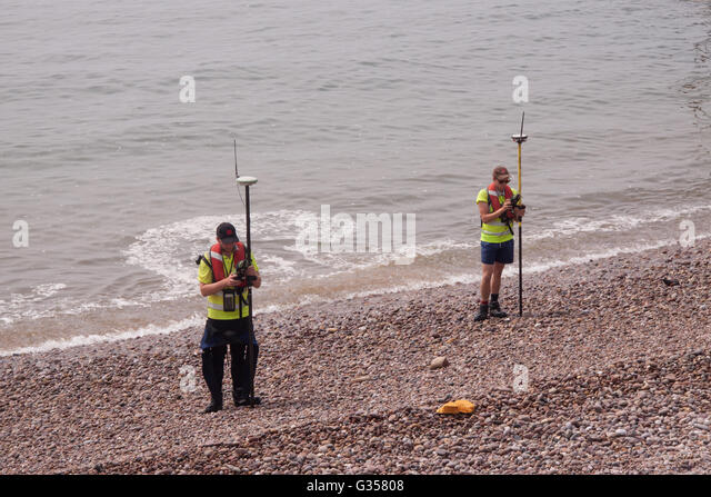 Shoreline and beach at Sidmouth, Devon, undergoing a GPS based survey by staff of EDI Surveys. - Stock Image