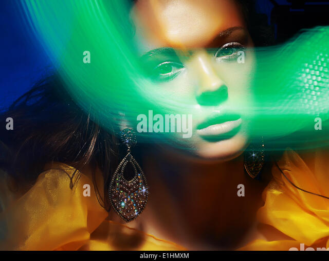 Diffuse. Fantasy. Silhouette of Woman's Face in Magic Disco Fog - Stock Image