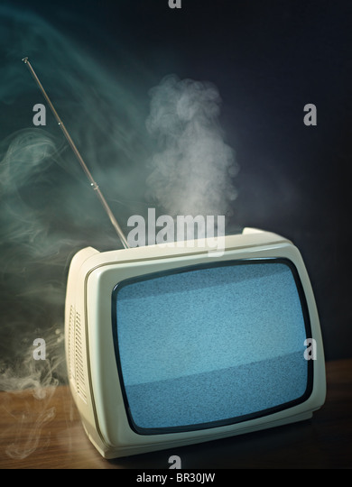 broken tv about to explode. Studio shot, vertical shape, copy space - Stock Image