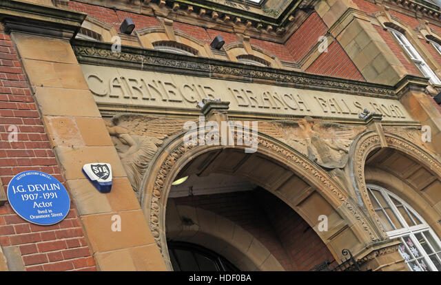 Belfast Falls Rd Carnegie Branch Library Facade & Entrance, with JG Devlin blue plaque - Oranmore Street - Stock Image