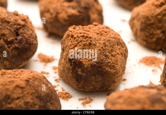 Handmade chocolate truffles in cocoa powder - Stock Image