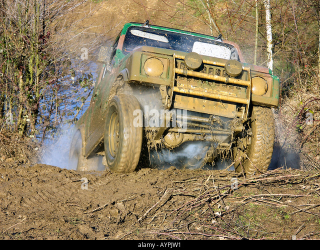 4x4 Vehicle Cresting a Rise - Stock Image